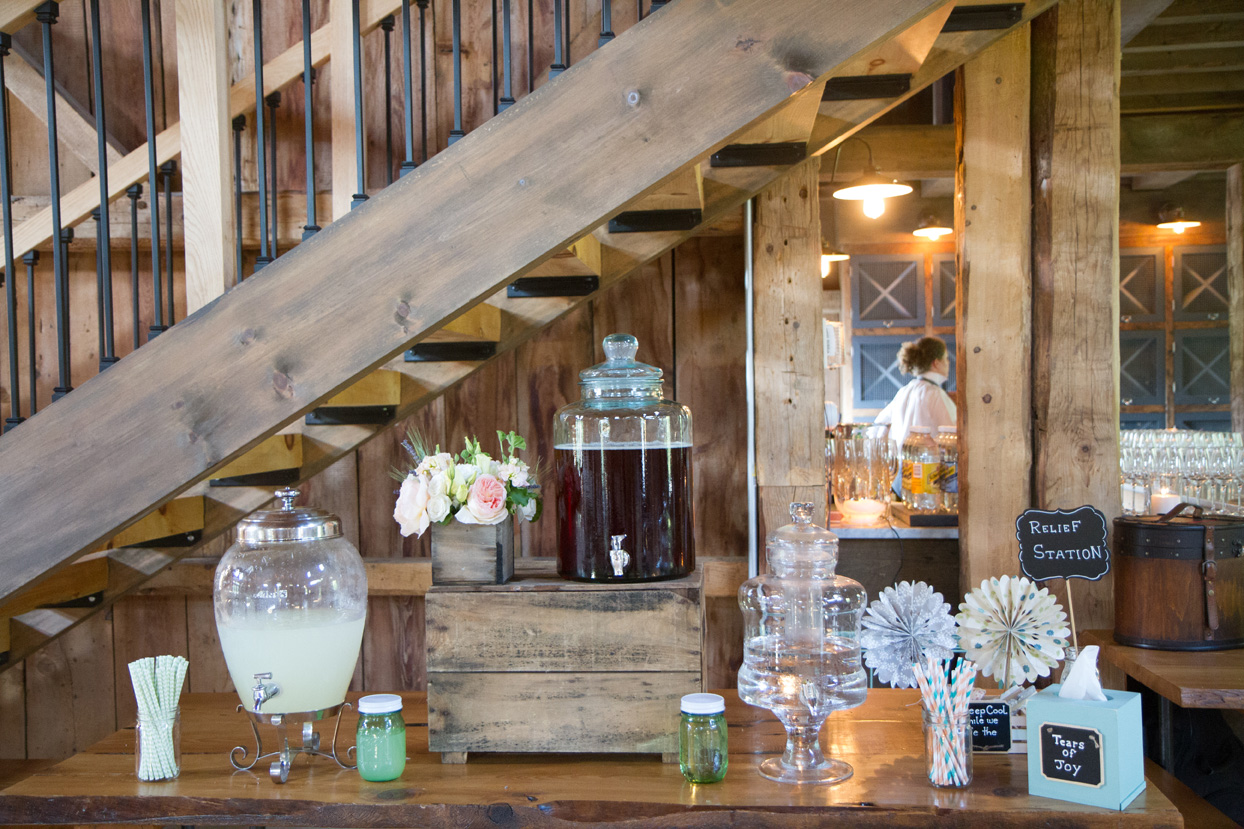 A rustic display of lemonade and tea for a Maine barn wedding. www.churchillcaterers.com Photo Courtesy of Kivalo Photography