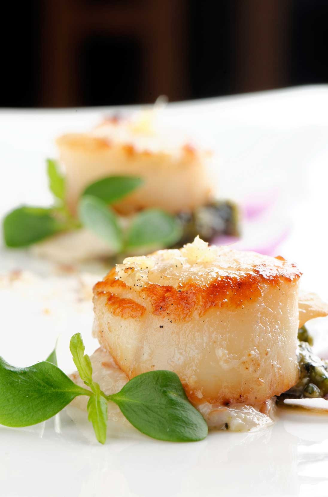 Pan-seared diver-harvested sea scallops are a highlight of our dinner menu.