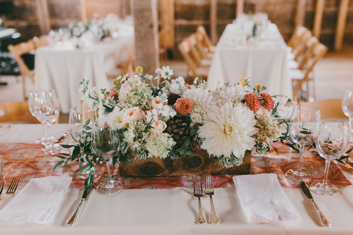 Creative Table Design - The eclectic blend of succulents and flowers create unforgettable centerpieces for a Maine barn wedding.