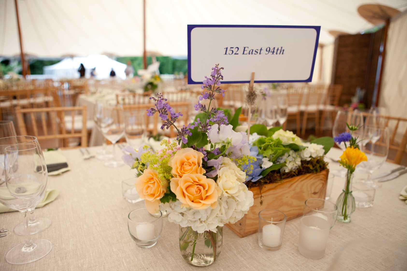 Roses and Maine wildflowers create simple, elegant place settings at this coastal Maine wedding. www.churchillevents.com