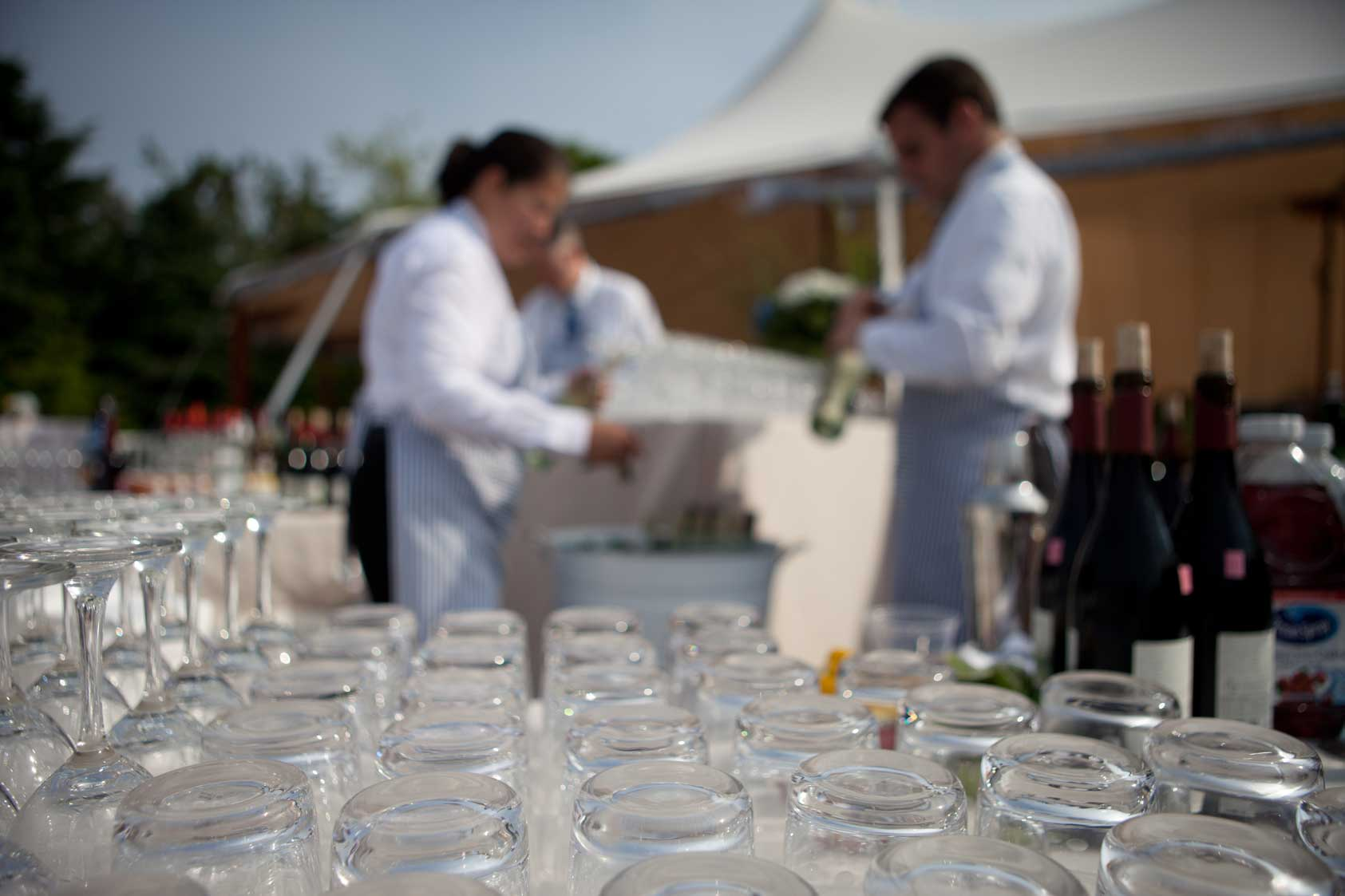 An array of glasses await full bar service at a Maine coastal wedding. www.churchillcaterers.com