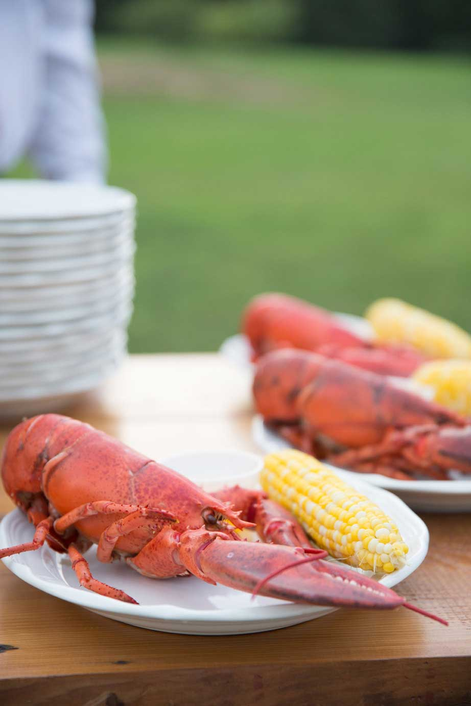The way it should be... A one and a quarter pound lobster served beside fresh drawn butter for a Maine wedding feast. Photo Courtesy of Kivalo Photography http://kivalophotographyblog.com