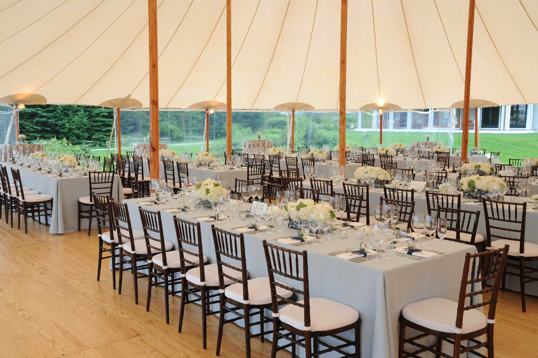 Prouts Neck wedding - White tablescapes and a grandiose tent create a striking backdrop for this Cape Elizabeth wedding. www.churchillcaterers.com