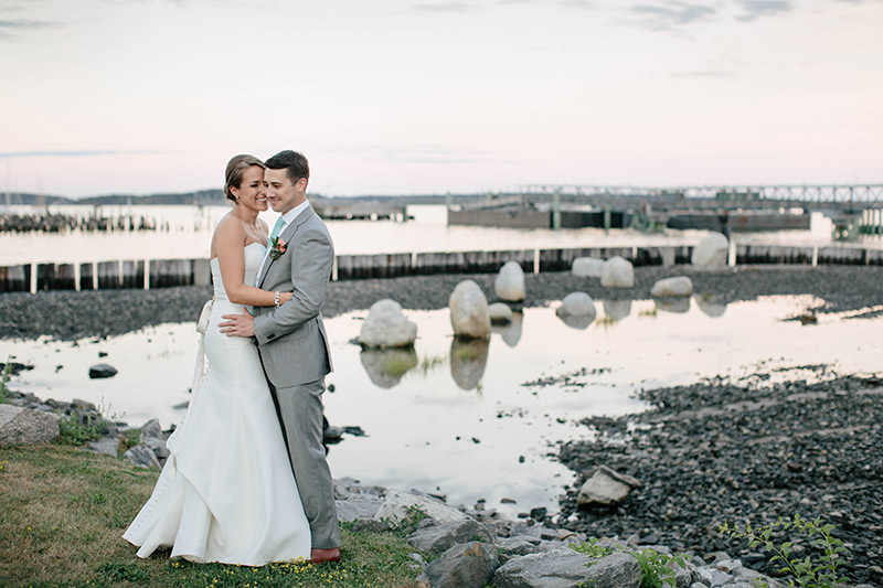 Photo of couple outside of Ocean Gateway wedding, photo courtesy of http://larakimmerer.typepad.com/lk_weblog/2016/01/karla-todd-ocean-gateway-wedding.html.