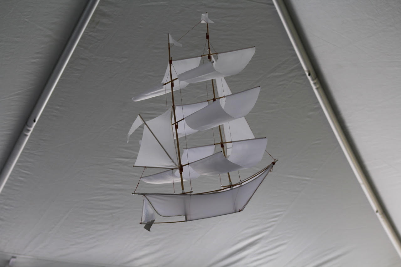 A paper sailboat hangs from the ceiling at Long Reach Hall.